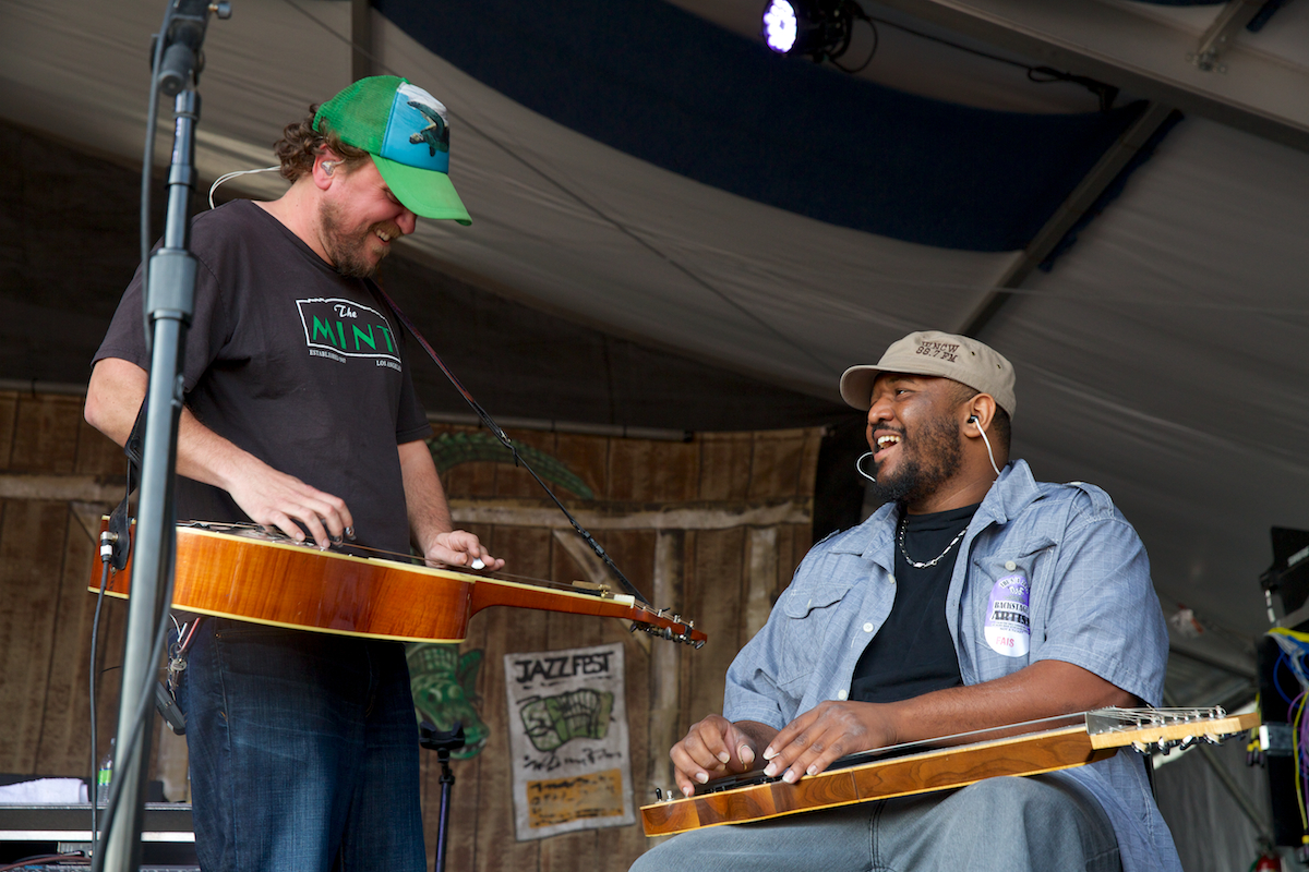 One good slide deserves another, Greensky Bluegrass' Anders Beck with Roosevelt Collier